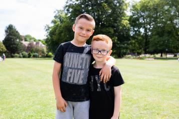 Two young boys with their arms round each other